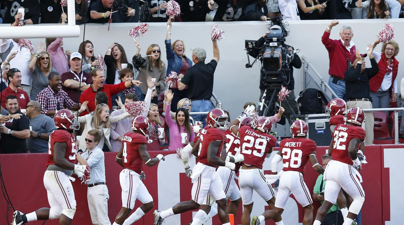 Alabama players celebrate after Alabama defensive lineman Jonathan Allen picked up a fumble and scored a touchdown during the second half of an NCAA college football game against Texas A&M, Saturday, Oct. 22, 2016, in Tuscaloosa, Ala. (AP Photo/Brynn Ande