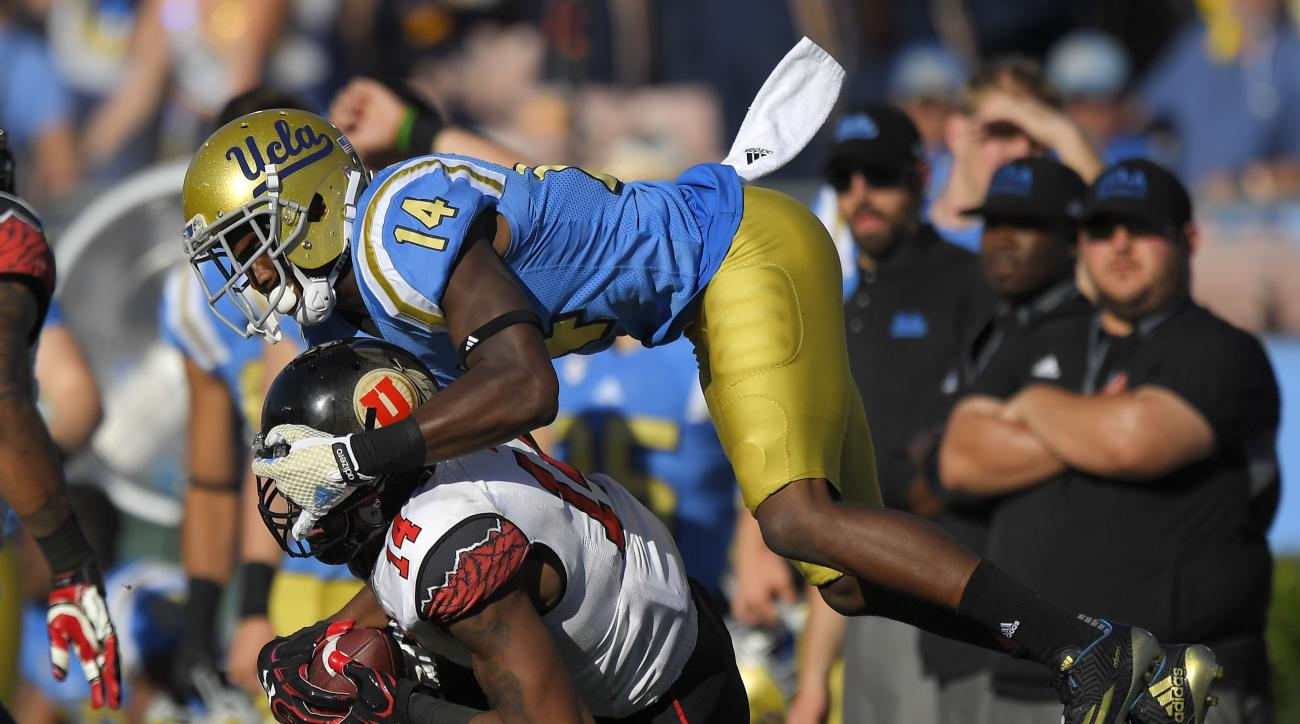 Utah defensive back Brian Allen, below, intercepts a pass intended for UCLA wide receiver Theo Howard during the second half of an NCAA college football game, Saturday, Oct. 22, 2016, in Pasadena, Calif. Utah won 52-45. (AP Photo/Mark J. Terrill)