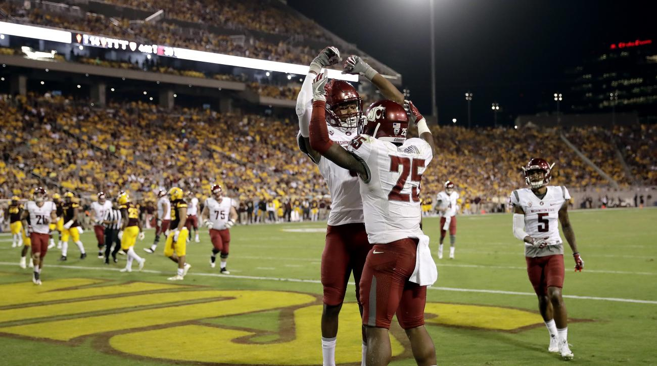 Washington State running back Jamal Morrow (25) celebrates his touchdown catch with teammate Isaiah Johnson-Mack during the second half of an NCAA college football game against Arizona State, Saturday, Oct. 22, 2016, in Tempe, Ariz. (AP Photo/Matt York)
