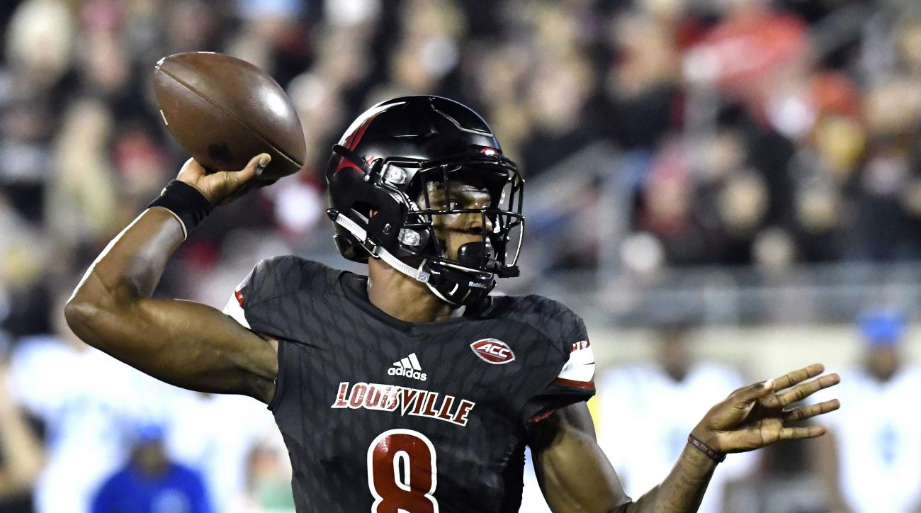 FILE - In this Oct. 14, 2016, file photo, Louisville's Lamar Jackson (8) attempts a pass during the first half of an NCAA college football gamen against Duke, in Louisville, Ky. Jackson is on pace to run away with the Heisman. (AP Photo/Timothy D. Easley,