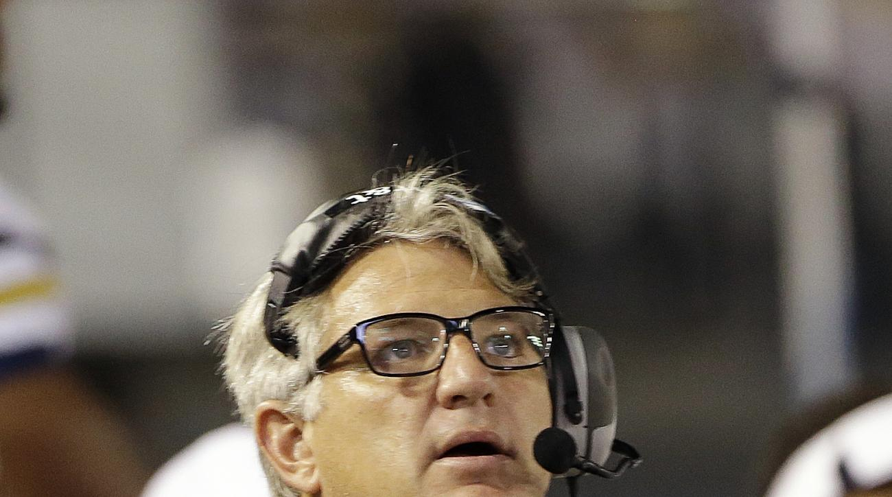 FILE - In this Sept. 26, 2013, file photo, Georgia Tech defensive coordinator Ted Roof looks on in the second half of an NCAA college football game against Virginia Tech in Atlanta. Here's a change: Roof's Georgia Tech defense ranks higher than its offens