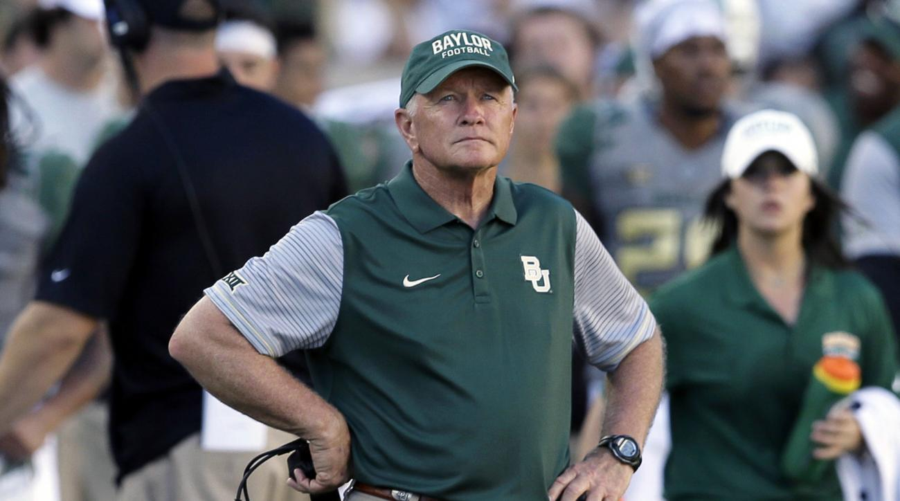 FILE - In this Sept. 10, 2016, file photo, Baylor acting head coach Jim Grobe watches from the sideline during the second half of an NCAA college football game against SMU in Waco, Texas. With Baylor and West Virginia still undefeated before the first CFP