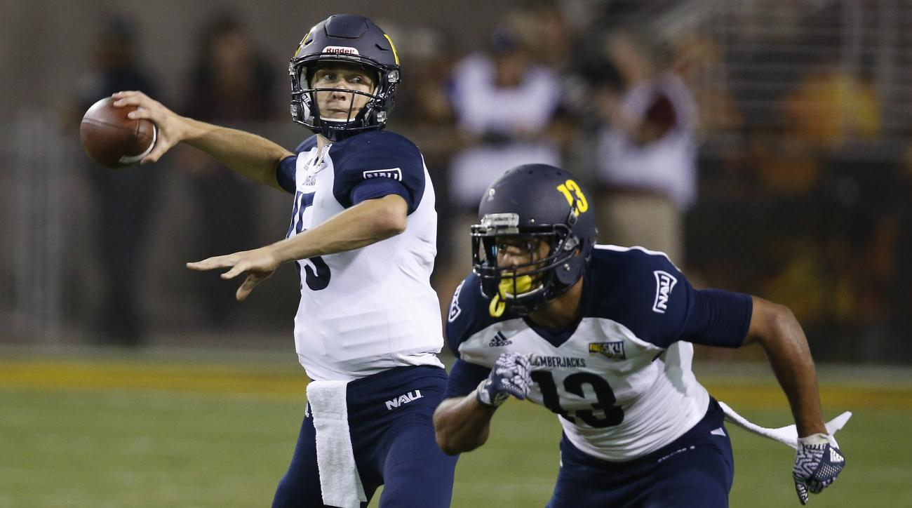 Northern Arizona's Case Cookus, left, looked to pass the football as Kendyl Taylor (13) runs his route against Arizona State during the first half of an NCAA college football game Saturday, Sept. 3, 2016, in Tempe, Ariz. (AP Photo/Ross D. Franklin)