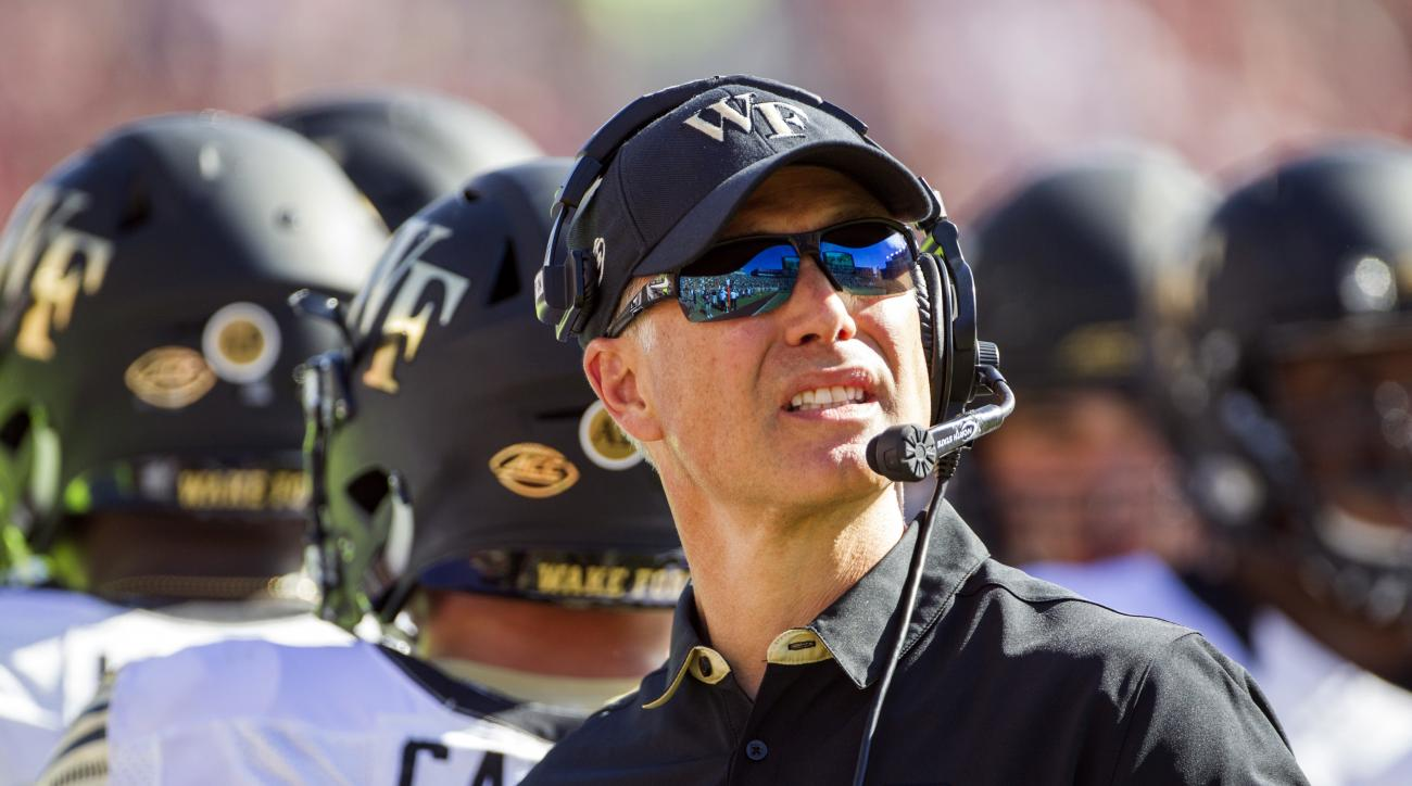 FILE - In this Oct. 15, 2016, file photo, Wake Forest head coach Dave Clawson looks at the scoreboard in the first half of an NCAA college football game against Florida State in Tallahassee, Fla., Another Clemson-Florida State matchup in the Top 25, anoth