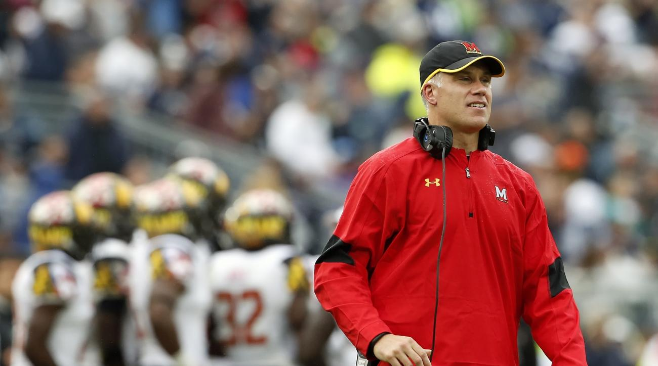 FILE - In this Oct. 8, 2016, file photo, Maryland head coach DJ Durkin watches from the sidelines against Penn State during the second half of an NCAA college football game in State College, Pa. After going 3-9 last season and winning only one Big Ten gam