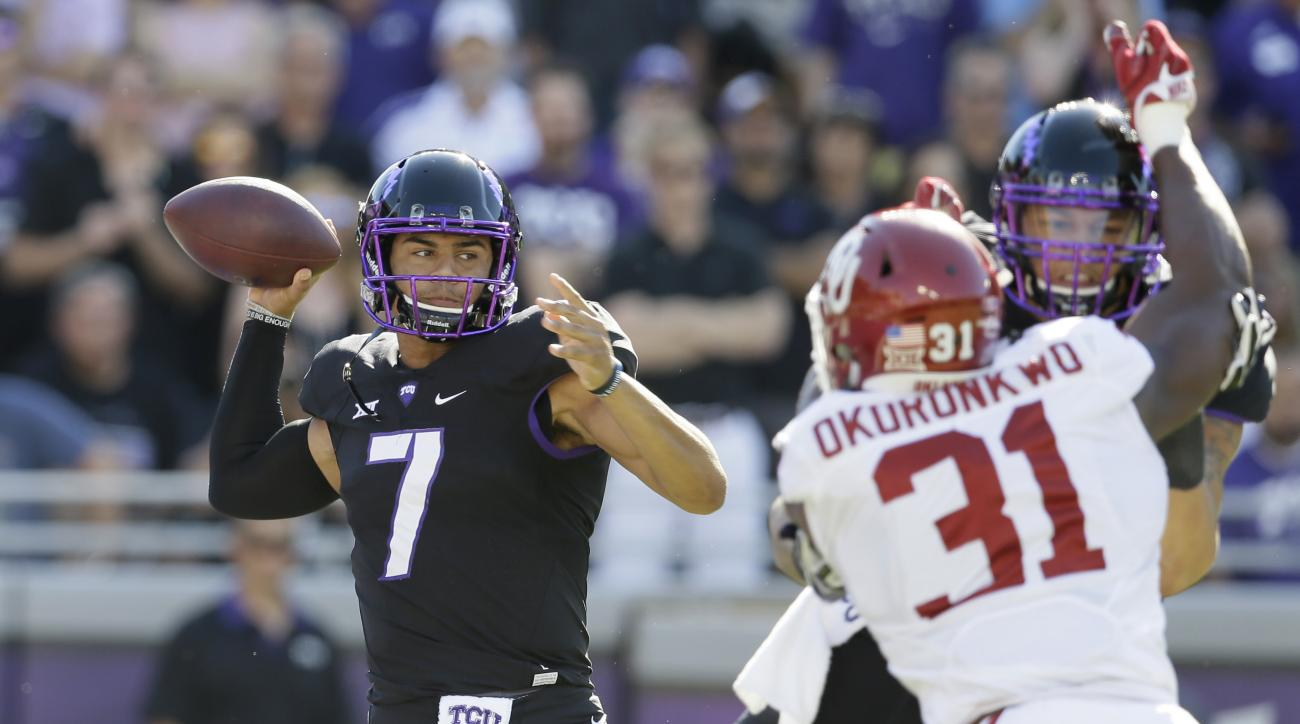 FILE  - In this Saturday, Oct. 1, 2016 file photo, TCU quarterback Kenny Hill (7) passes as Garrett Altman blocks Oklahoma linebacker Ogbonnia Okoronkwo (31) during the first quarter of an NCAA college football game in Fort Worth, Texas. Patrick Mahomes,