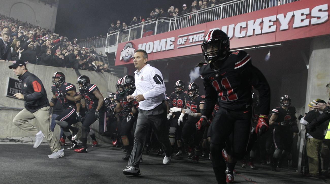 FILE - In this Oct. 17, 2015, file photo, Ohio State head coach Urban Meyer leads his team on to the field before their NCAA college football game against Penn State in Columbus, Ohio. Ohio State considers last weeks stunning upset by Penn State an aberra