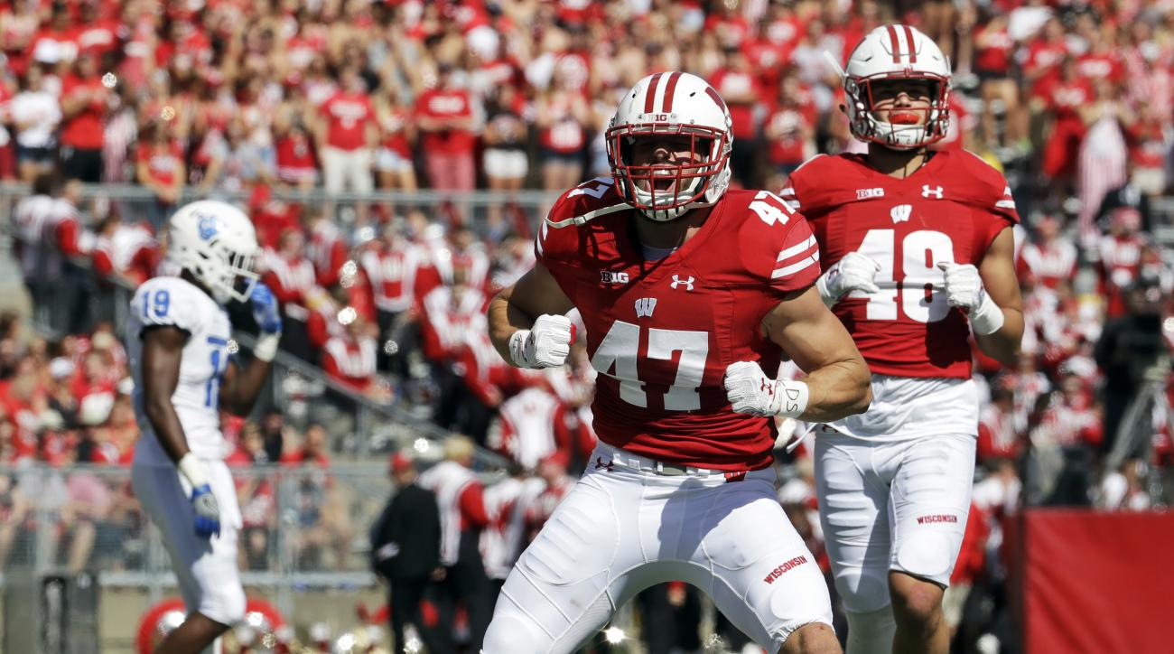 FILE - In this Sept. 17, 2016, file photo, Wisconsin's Vince Biegel (47) celebrates after breaking up a third down play during the first half of an NCAA college football game against Georgia State, in Madison, Wis. The tested Badgers are facing their fift