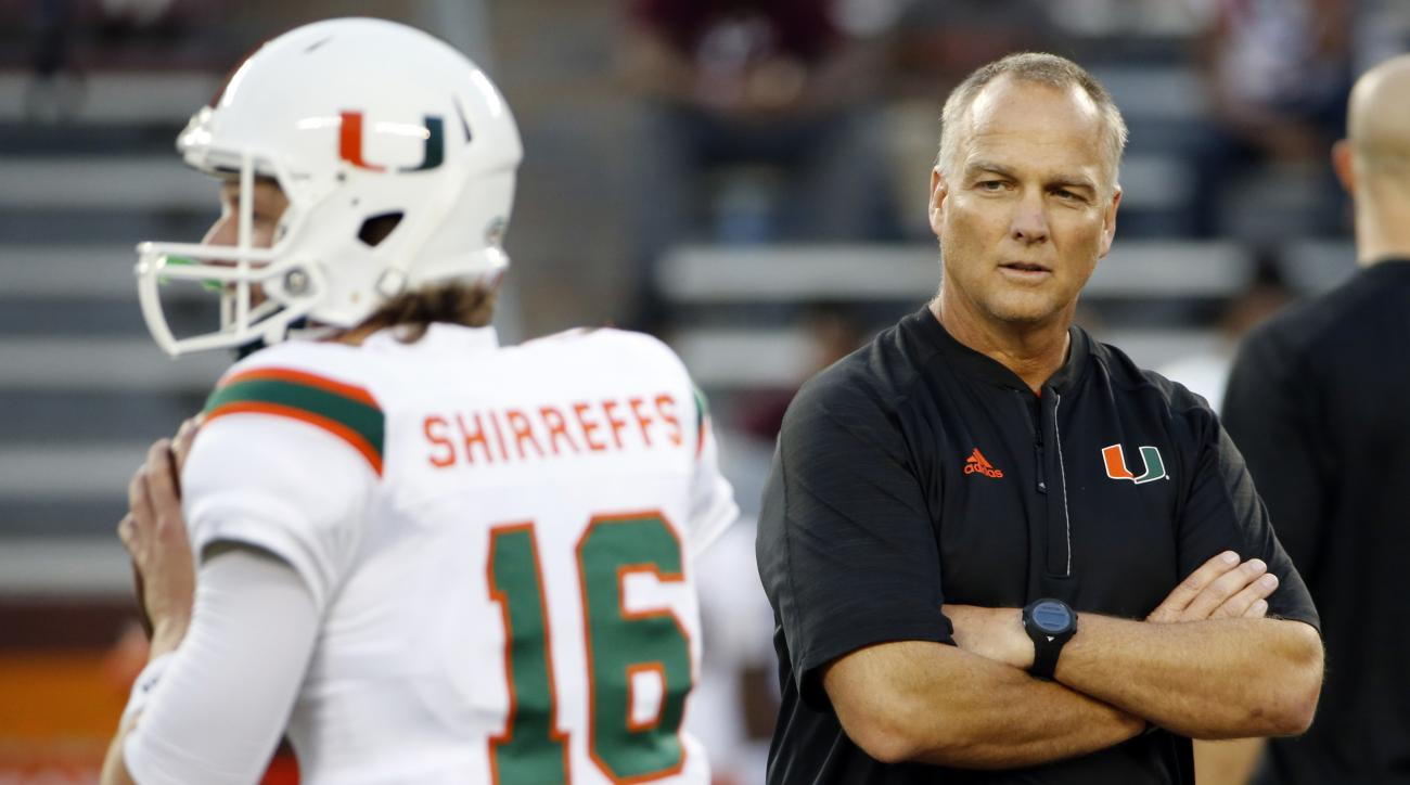 FILE - In this Thursday, Oct. 20, 2016, file photo, Miami head coach Mark Richt watches warm ups before an NCAA college football game against Virginia Tech at Lane stadium in Blacksburg, Va., Miami and Notre Dame can only wish their game Saturday could co