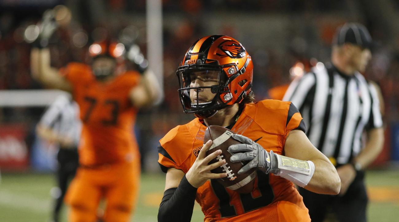FILE - In this Oct. 8, 2016, file photo, Oregon State quarterback Darell Garretson runs into the end zone with the winning touchdown in overtime in an NCAA college football game against California, in Corvallis, Ore. Oregon State hosts Washington State on