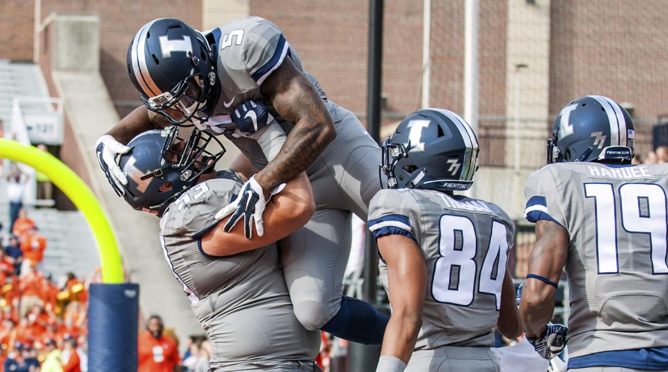 Illinois offensive lineman Nick Allegretti (53) and wide receiver Dominic Thieman (84) celebrate running back Ke'Shawn Vaughn's (5) touchdown in the first quarter of an NCAA college football game against Minnesota, Saturday, Oct. 29, 2016, at Memorial Sta