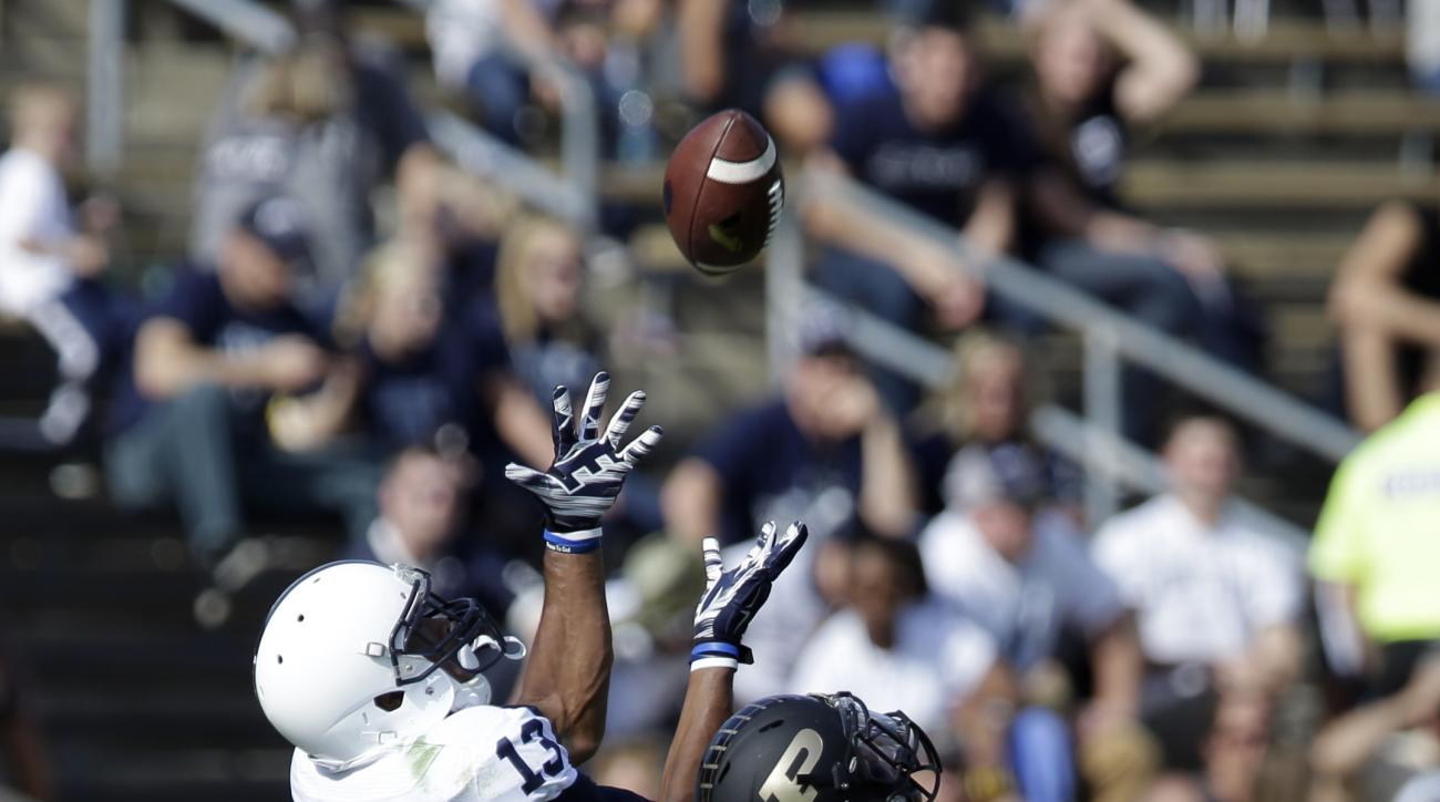 Penn State wide receiver Saeed Blacknall (13) makes a catch over Purdue defensive end Gelen Robinson (13) for a 42-yard gain during the second half of an NCAA college football game in West Lafayette, Ind., Saturday, Oct. 29, 2016. Penn State defeated Purd