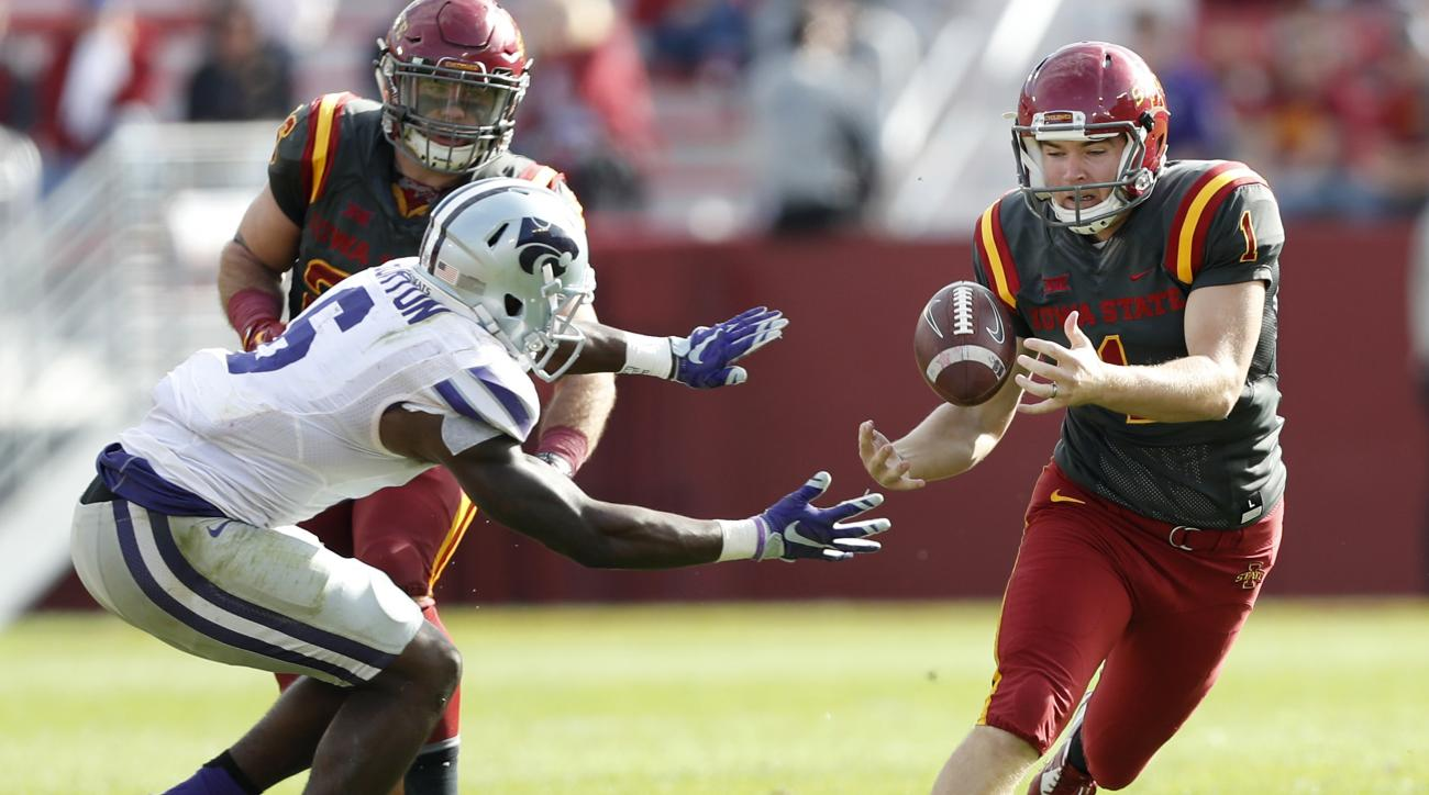 Kansas State's Deante Burton, left, and Iowa State place kicker Cole Netten fight for an onside kick during the second half of an NCAA college football game, Saturday, Oct. 29, 2016, in Ames, Iowa. Kansas State was awarded possession of the ball due to a