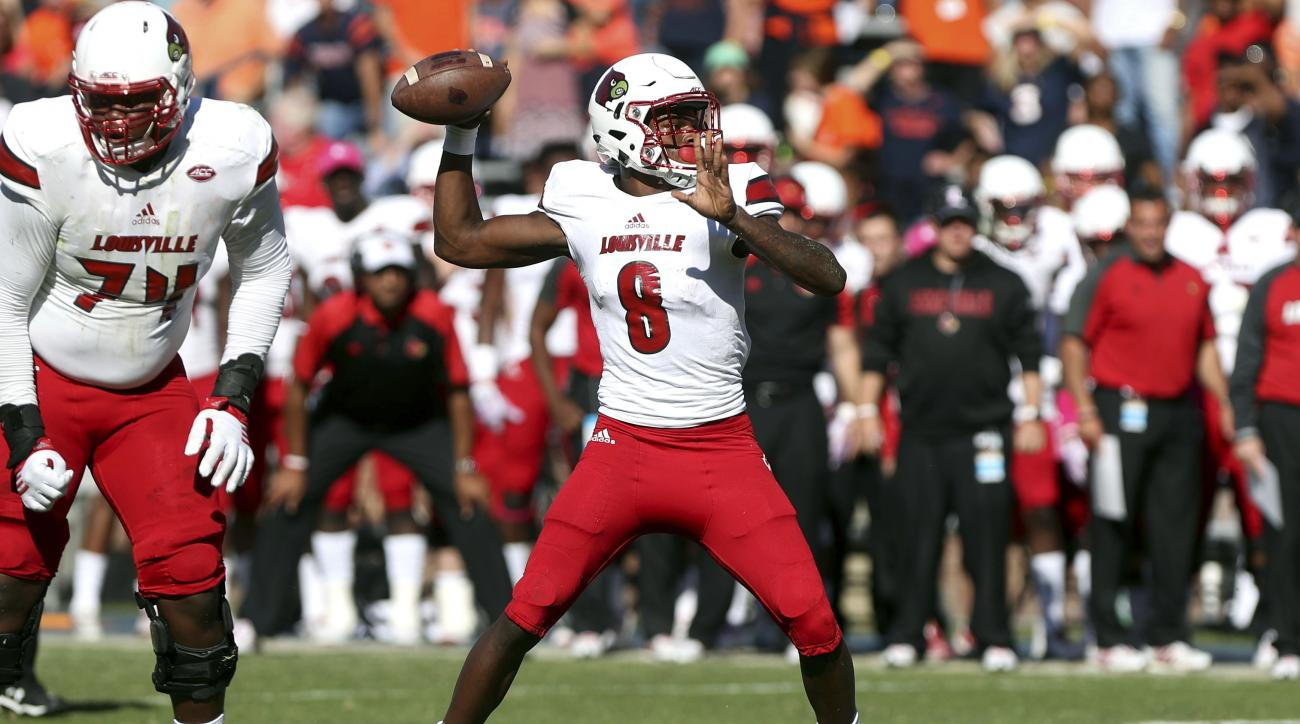 Louisville quarterback Lamar Jackson (8) throws a touchdown during the first half of an NCAA college football game on Saturday, Oct. 29, 2016 in Charlottesville, Va. Louisville defeated Virginia 32-25. (AP Photo/Ryan M. Kelly)