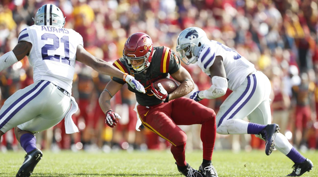 Iowa State wide receiver Allen Lazard, center, makes a reception between Kansas State's Kendall Adams, left, and Charmeachealle Moore, right, during the second half of an NCAA college football game, Saturday, Oct. 29, 2016, in Ames, Iowa. Kansas State won