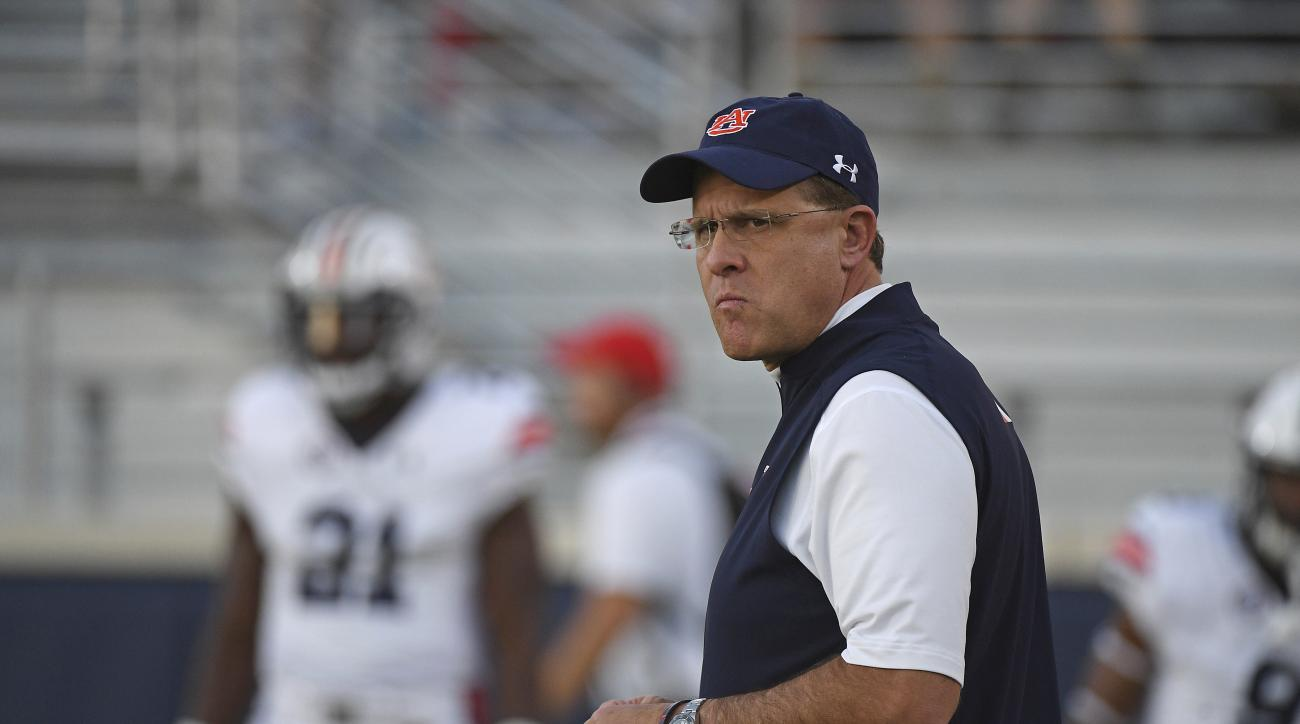 Auburn head coach Gus Malzahn watche warmups before an NCAA college football game against Mississippi in Oxford, Miss., Saturday, Oct. 29, 2016. (AP Photo/Thomas Graning)