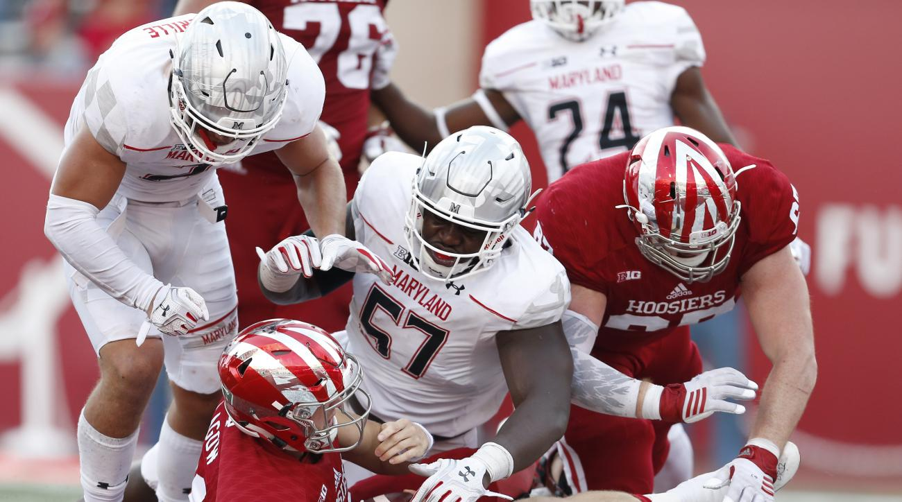 Indiana quarterback Richard Lagow (21) scores on this run against Maryland defensive lineman Kingsley Opara (57) during the second half of an NCAA college football game in Bloomington, Ind., Saturday, Oct. 29, 2016. Indiana won the game 42-36. (AP Photo/S