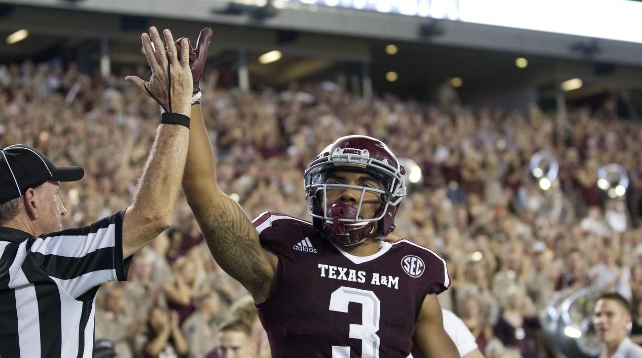Texas A&M's Christian Kirk (3) celebrates a touchdown against New Mexico State during the second quarter of an NCAA college football game Saturday, Oct. 29, 2016, in College Station, Texas. (AP Photo/Sam Craft)