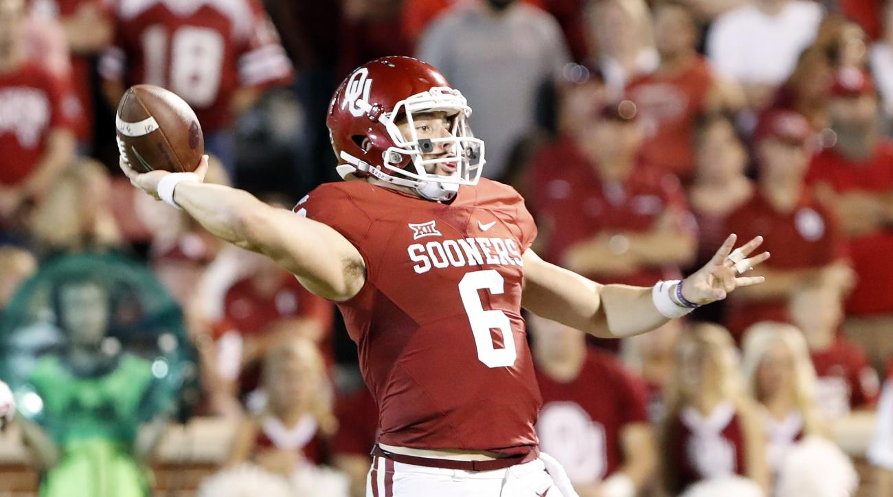 Oklahoma quarterback Baker Mayfield (6) passes against Kansas during the second half of an NCAA college football game in Norman, Okla., Saturday, Oct. 29, 2016.  (AP Photo/Alonzo Adams)