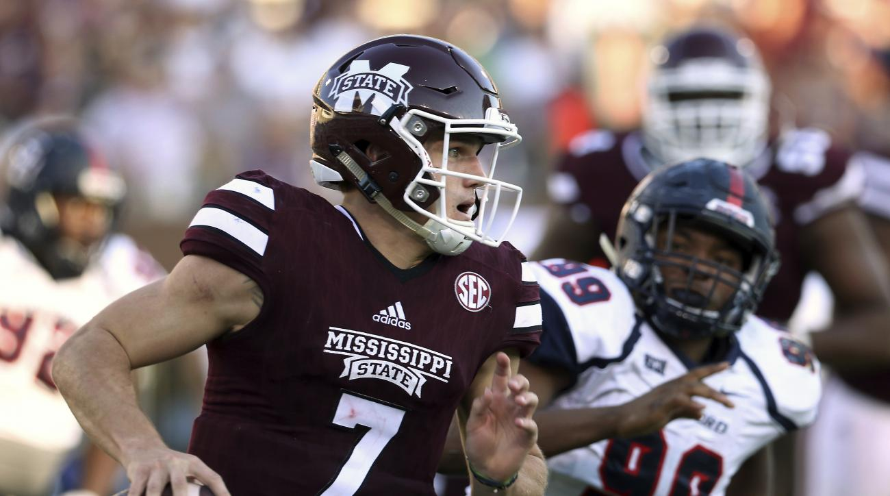 Mississippi State quarterback Nick Fitzgerald (7) rushes as Samford defensive lineman Ahmad Gooden (99) closes in for the tackle during the second half of an NCAA college football game in Starkville, Miss., Saturday, Oct. 29, 2016. (AP Photo/Jim Lytle)