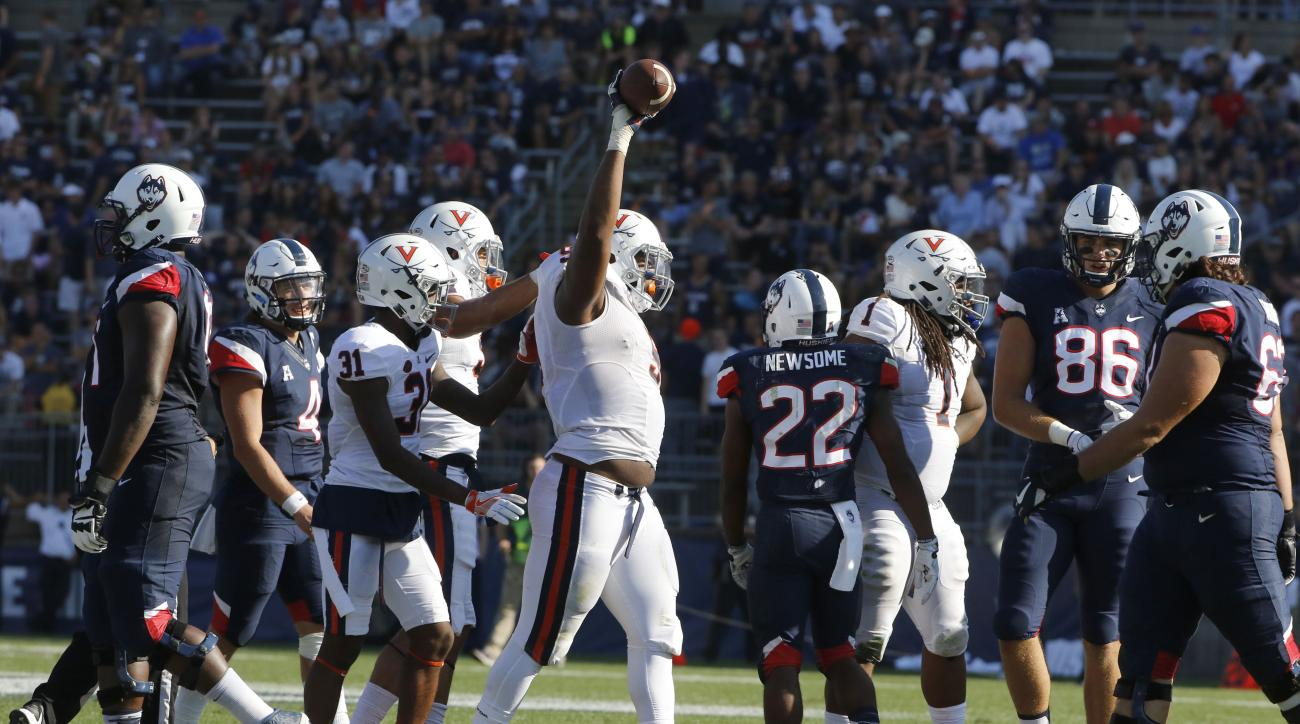 FILE - In a Saturday, Sept. 17, 2016 file photo, Virginia's Andrew Brown (9) holds the ball aloft after a fumble recovery against Connecticut in the second half of an NCAA college football game at Pratt & Whitney Stadium at Rentschler Field, in East Hartf