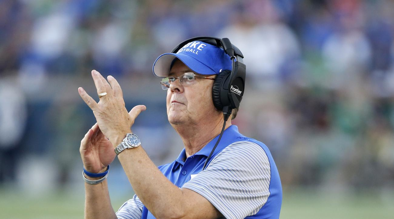 FILE - In a Saturday, Sept. 24, 2016 file photo, Duke head coach David Cutcliffe calls a timeout during the second half of an NCAA college football game against Notre Dame, in South Bend, Ind. Duke isn't just losing games these days. It's also losing capt