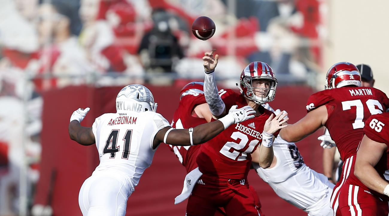 FILE - In a Saturday, Oct. 29, 2016 file photo, Indiana quarterback Richard Lagow (21) throws as Maryland defensive lineman Jesse Aniebonam  rushes in during the first half of an NCAA college football game in Bloomington, Ind. Maryland first-year coach DJ