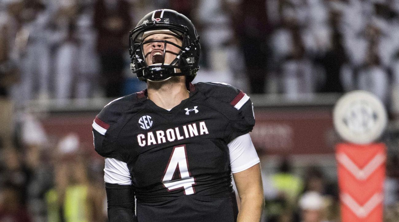 FILE - In this Saturday, Oct. 29, 2016, file photo, South Carolina quarterback Jake Bentley (4) celebrates a touchdown during the first half of an NCAA college football game against Tennessee in Columbia, S.C. A South Carolina offense that once looked stu