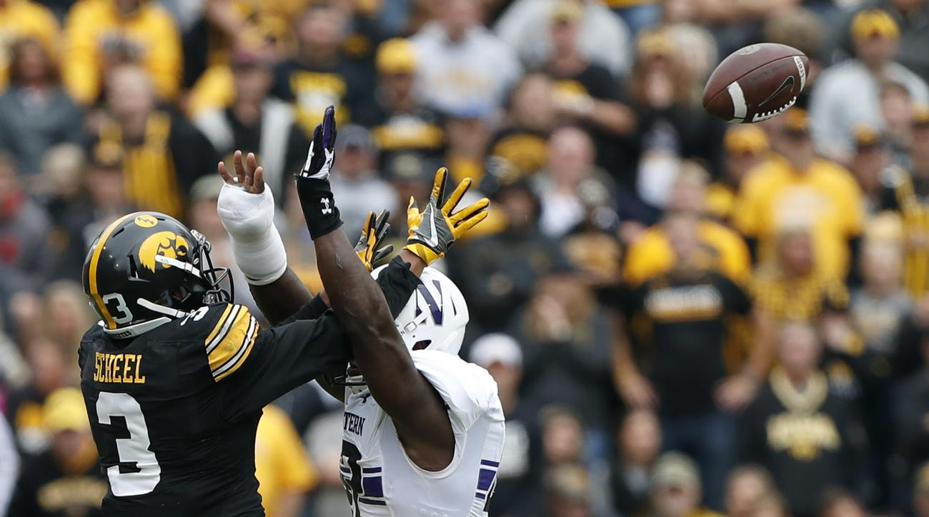 FILE - In this Oct. 1, 2016, file photo, Northwestern linebacker Joseph Jones, right, breaks up a pass intended for Iowa wide receiver Jay Scheel (3) during the first half of an NCAA college football game in Iowa City, Iowa. Iowa is just 107th nationally