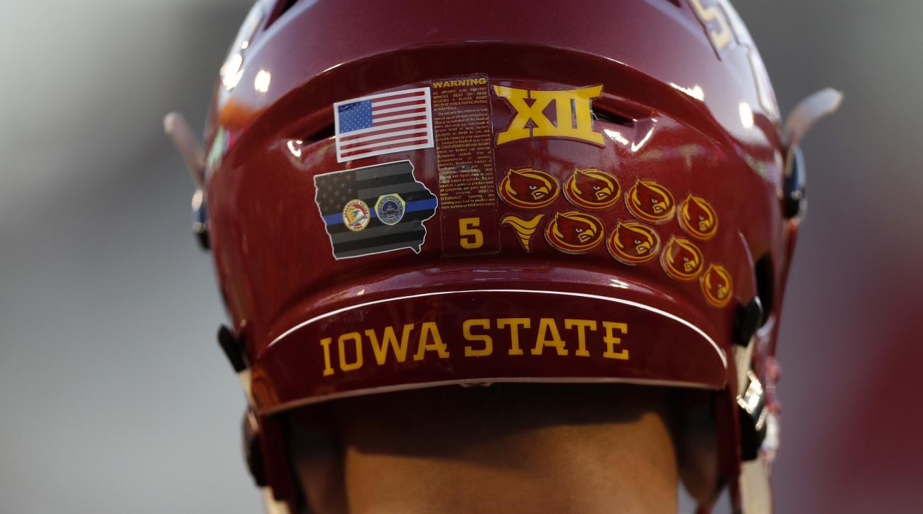 Iowa State wide receiver Allen Lazard wears a decal on his helmet honoring two Des Moines-area police officers that were killed early Wednesday morning before an NCAA college football game against Oklahoma, Thursday, Nov. 3, 2016, in Ames, Iowa. (AP Photo