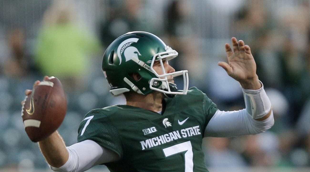FILE - In this Oct. 15, 2016, file photo, Michigan State quarterback Tyler O'Connor throws a pass against Northwestern during the fourth quarter of an NCAA college football game, in East Lansing, Mich. Looking at the schedule back in August, Michigan Stat