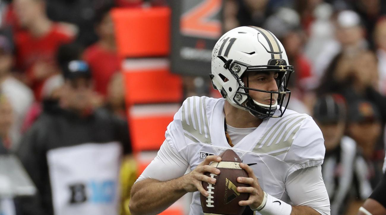 FILE - In this Oct. 1, 2016, file photo, Purdue quarterback David Blough looks for a receiver in the first half of an NCAA college football game against Maryland, in College Park, Md. Minnesota hosts Purdue on Saturday. (AP Photo/Patrick Semansky, File)