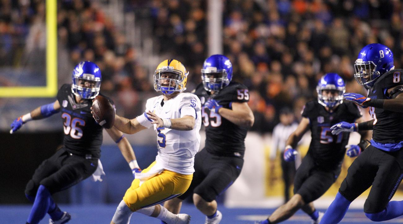 San Jose State quarterback Kenny Potter (5) scrambles as Boise State players close in during the first half of an NCAA college football game in Boise, Idaho, Friday, Nov. 4, 2016. (AP Photo/Otto Kitsinger)