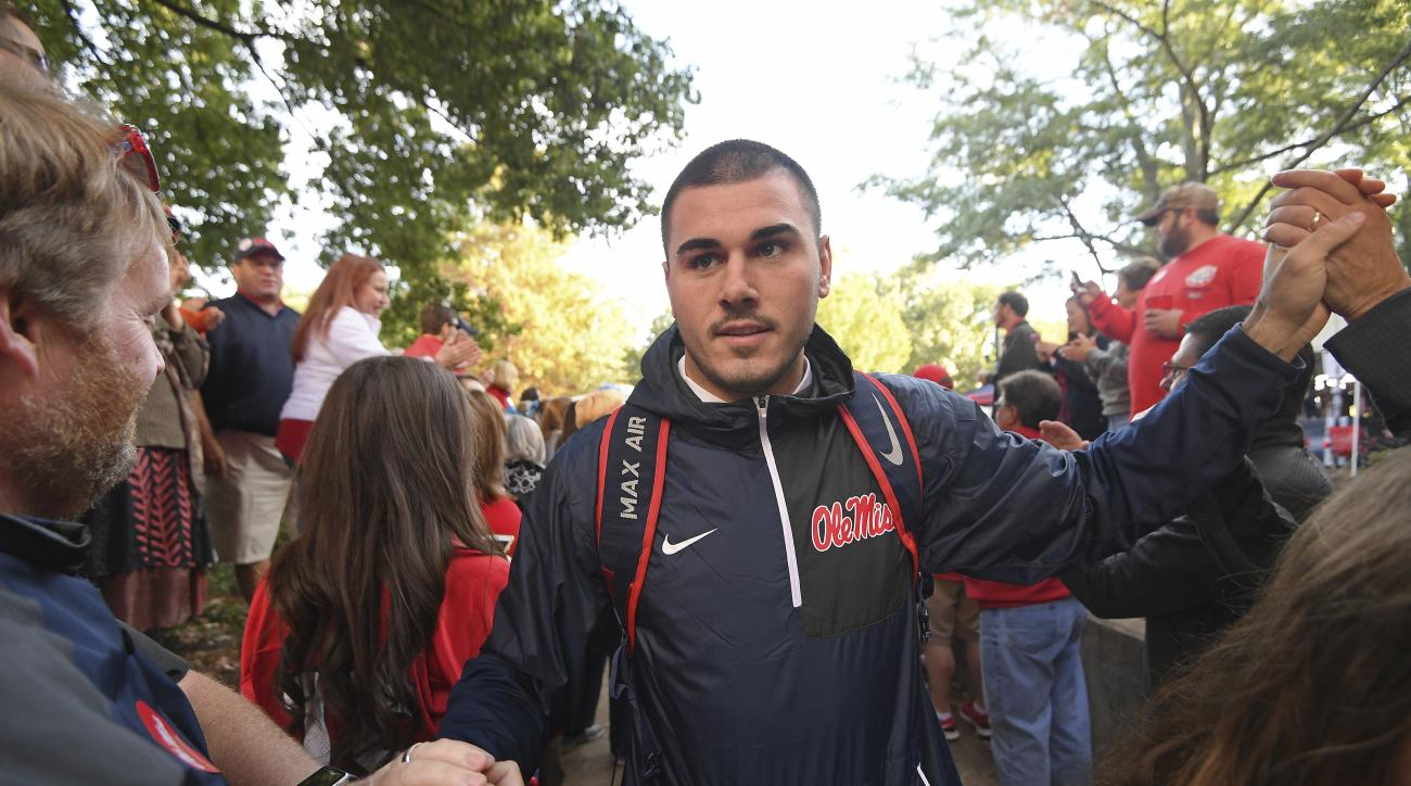 Mississippi quarterback Chad Kelly greets fans during the Walk of Champions in the Grove before an NCAA college football game between Mississippi and Georgia Southern in Oxford, Miss., Saturday, Nov. 5, 2016. (AP Photo/Thomas Graning)