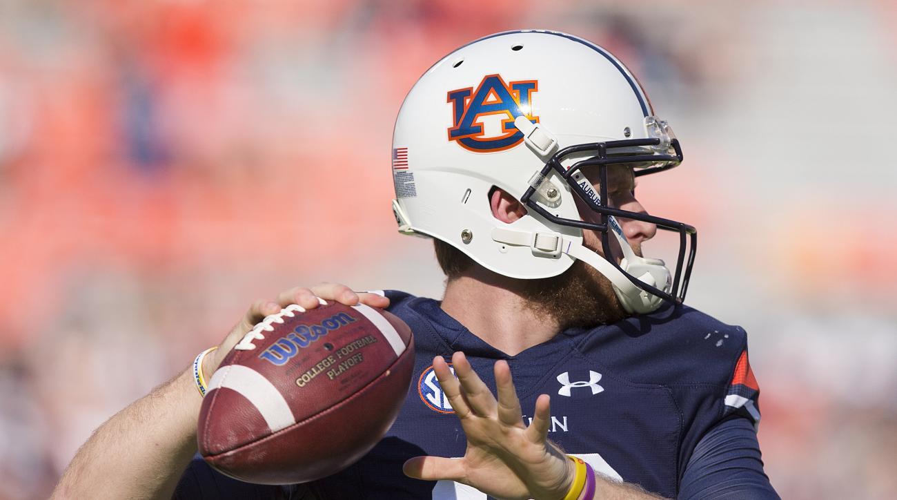 Auburn quarterback Sean White sets back pass the ball during practice before the first half of an NCAA college football game against Vanderbilt,  Saturday, Nov. 5, 2016, in Auburn, Ala. (AP Photo/Brynn Anderson)