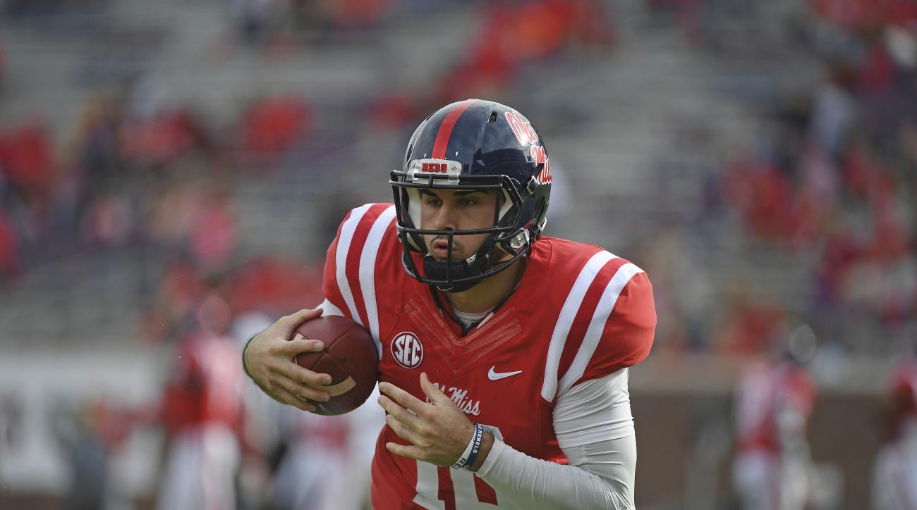Mississippi quarterback Chad Kelly (10) warms up before an NCAA college football game against Georgia Southern in Oxford, Miss., Saturday, Nov. 5, 2016. (AP Photo/Thomas Graning)
