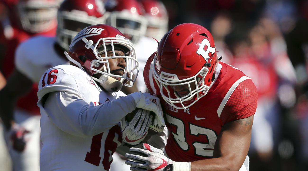 Rutgers running back Justin Goodwin (32) tries to hold on as Indiana defensive back Rashard Fant (16) tries to strip the ball during the first half of a NCAA college football game Saturday, Nov. 5, 2016, in Piscataway, N.J. (AP Photo/Mel Evans)
