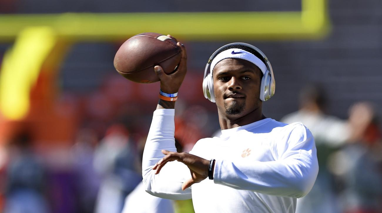 Clemson quarterback Deshaun Watson warms up before the start of an NCAA college football game against Syracuse, Saturday, Nov. 5, 2016, in Clemson, S.C. (AP Photo/Richard Shiro)