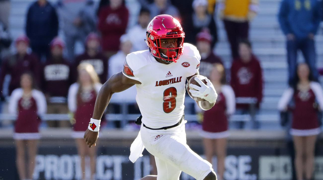 Louisville quarterback Lamar Jackson runs the ball during the second half of Louisville's 52-7 win over Boston College in an NCAA football game at Alumni Stadium in Boston, Saturday, Nov. 5, 2016. (AP Photo/Winslow Townson)