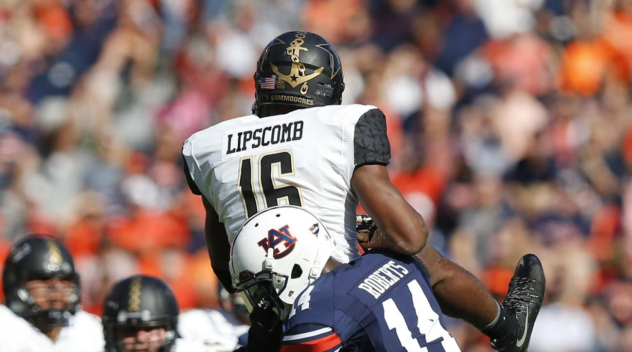 Auburn defensive back Stephen Roberts tackles Vanderbilt wide receiver Kalija Lipscomb during the first half of an NCAA college football game, Saturday, Nov. 5, 2016, in Auburn, Ala. (AP Photo/Brynn Anderson)