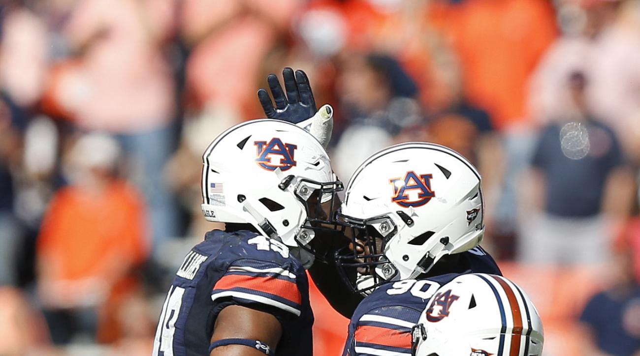 Auburn linebacker Darrell Williams, left, defensive lineman Maurice Swain Jr., center, and defensive lineman Derrick Brown celebrate during the second half of an NCAA college football game against Vanderbilt, Saturday, Nov. 5, 2016, in Auburn, Ala. Auburn