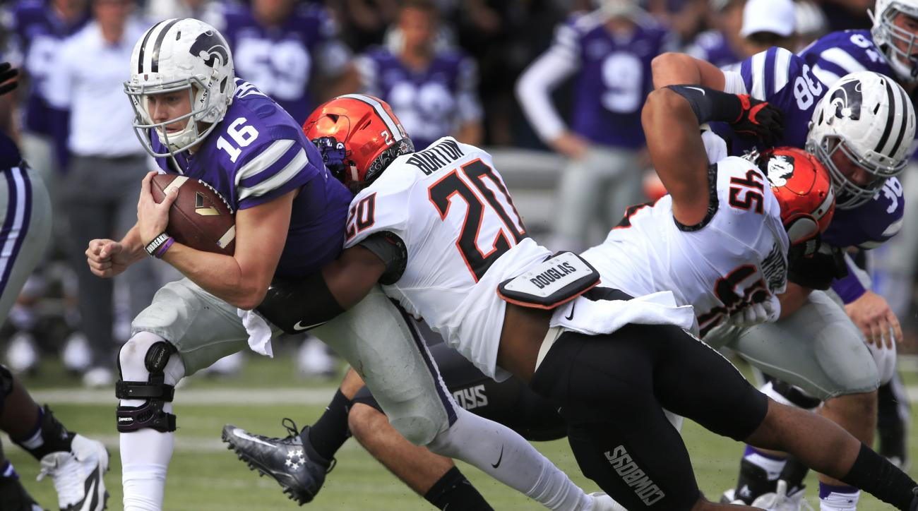 Kansas State quarterback Jesse Ertz (16) is tackled by Oklahoma State linebacker Jordan Burton (20) during the first half of an NCAA college football game in Manhattan, Kan., Saturday, Nov. 5, 2016. (AP Photo/Orlin Wagner)