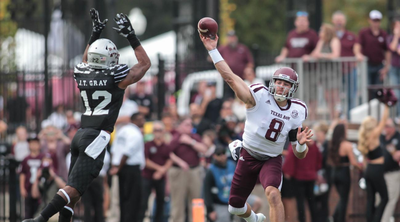 Mississippi State defender J.T. Gray (12) tries to block a pass from Texas A&M quarterback Trevor Knight (8) during their NCAA football game at Davis Wade Stadium at Scott Field in Starkville, Miss., Saturday, Nov. 5, 2016. Mississippi State won 35-28. (J