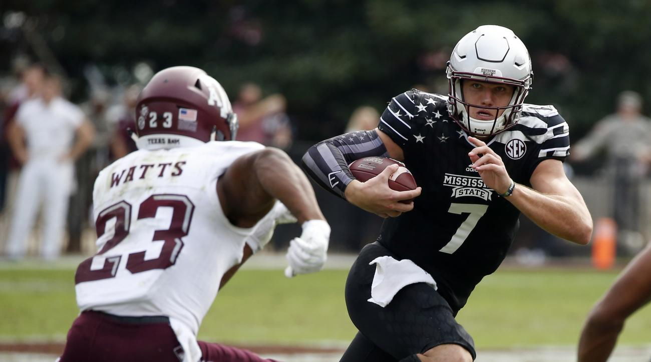 Mississippi State quarterback Nick Fitzgerald (7) runs past Texas A&M defensive back Armani Watts (23) for a first down during the second half of their NCAA college football game in Starkville, Miss., Saturday, Nov. 5, 2016. Mississippi State won 35-28. (