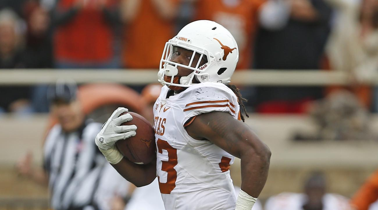 Texas' D'Onta Foreman (33) breaks away to score a touchdown during an NCAA college football game against Texas Tech, Saturday, Nov. 5, 2016, in Lubbock, Texas. (Brad Tollefson/Lubbock Avalanche-Journal via AP)