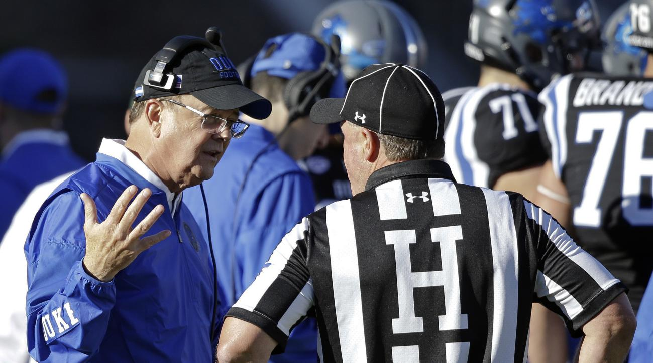 Duke coach David Cutcliffe speaks with an official during the first half of an NCAA college football game against Virginia Tech in Durham, N.C., Saturday, Nov. 5, 2016. (AP Photo/Gerry Broome)