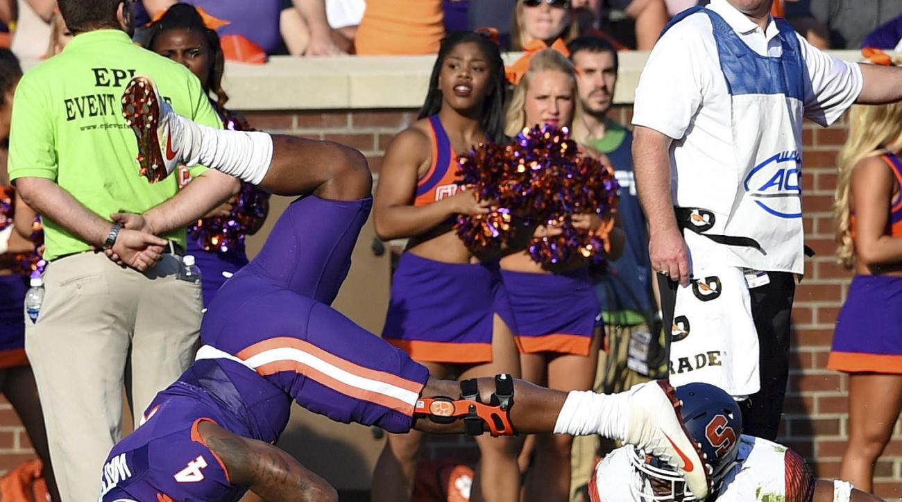 Clemson's quarterback Deshaun takes a hard landing after being tackled by Syracuse's Davion Ellison during the first half of an NCAA college football game Saturday, Nov. 5, 2016, in Clemson, S.C. (AP Photo/Richard Shiro)