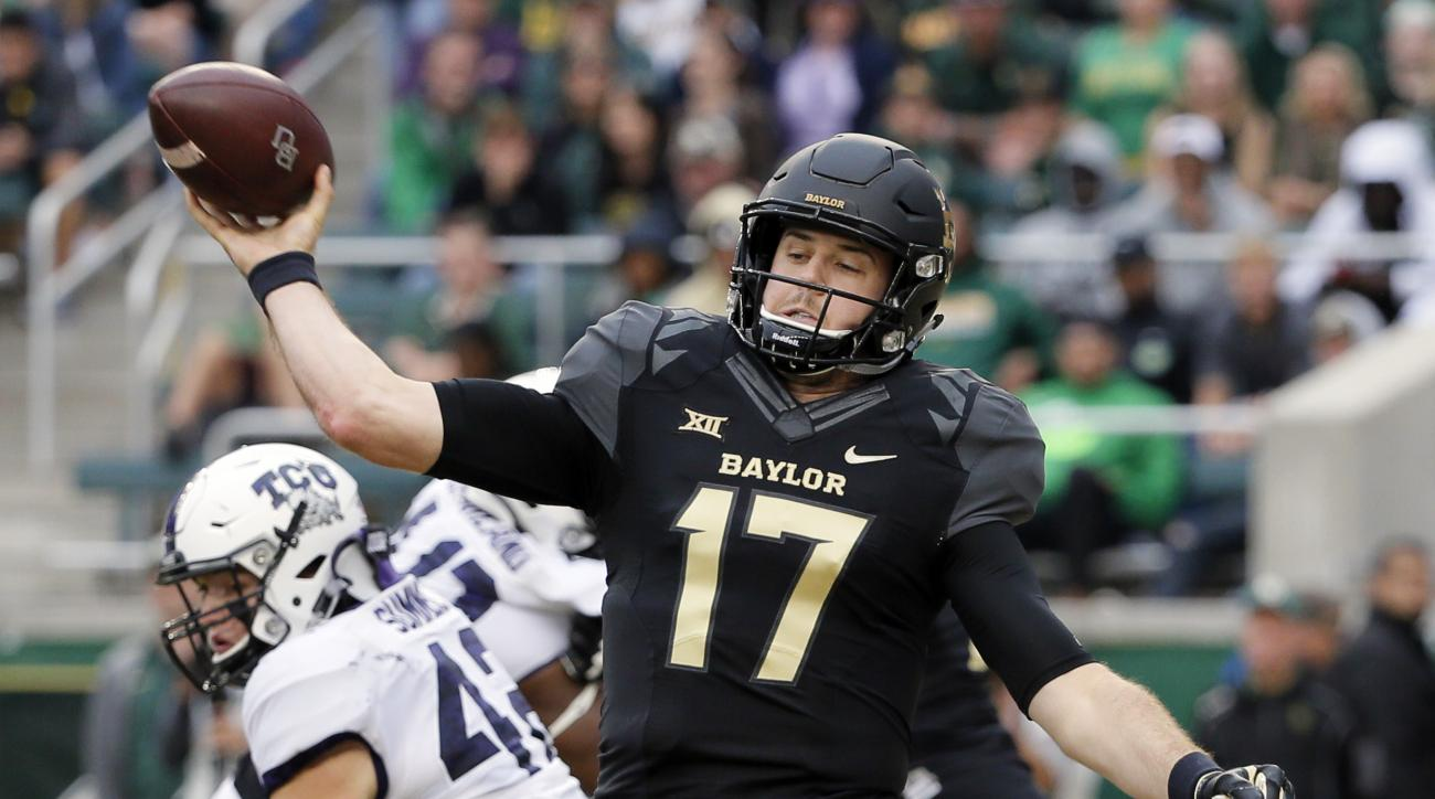 Baylor quarterback Seth Russell (17) throws a pass under pressure from Baylor safety Jairon McVea, rear, in the first half of an NCAA college football game, Saturday, Nov. 5, 2016, in Waco, Texas. (AP Photo/Tony Gutierrez)