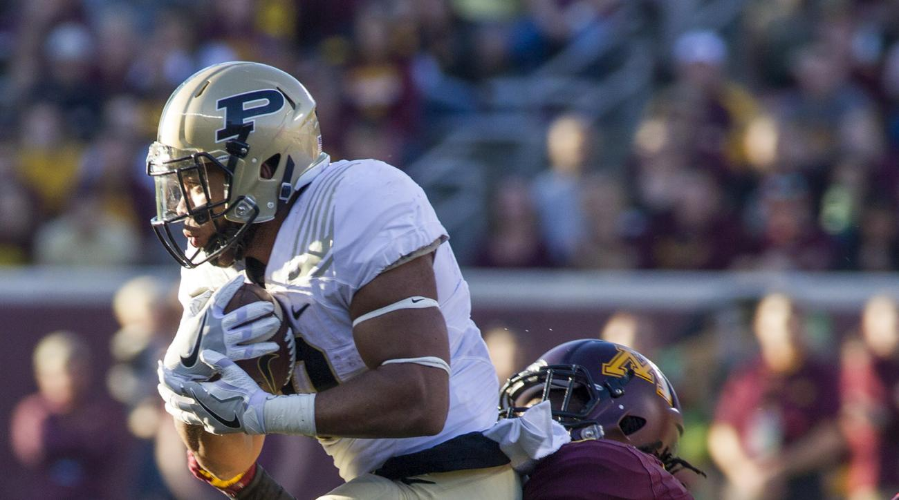Purdue running back Markell Jones, left, is tackled by Minnesota defensive back Duke McGhee (8) after a nine-yard run during the second half of an NCAA college football game, Saturday, Nov. 5, 2016, in Minneapolis. (AP Photo/Paul Battaglia)