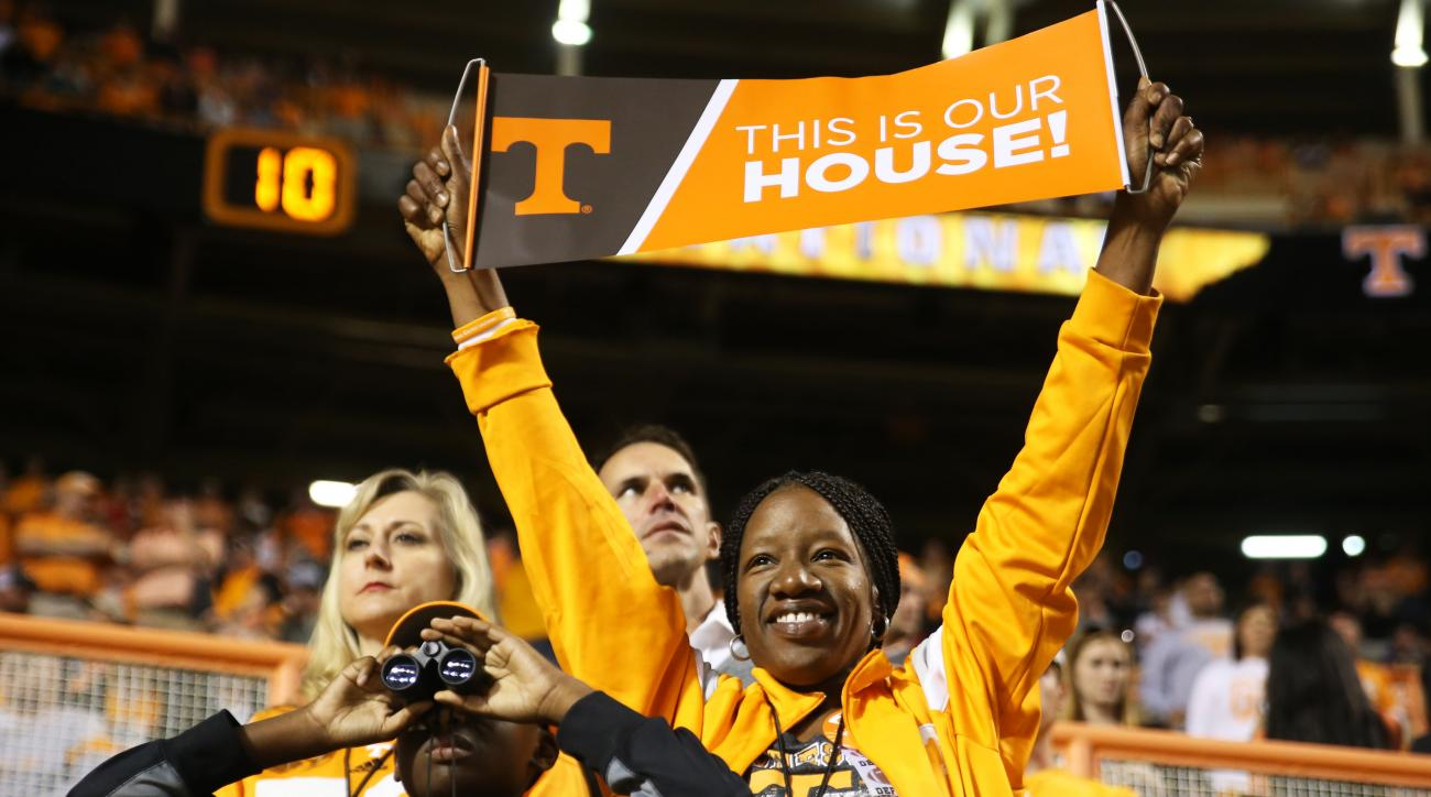 LaTonya Lewis-Becton, mother of Tennessee defensive lineman LaTroy Lewis, celebrates after a final UT touchdown during the second half of an NCAA college football game against Tennessee Tech, Saturday, Nov. 5, 2016, in Knoxville, Tenn. (Catie McMekin/Knox